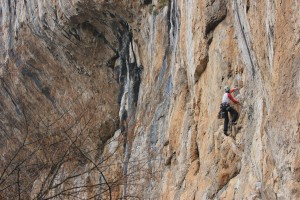 Nicola Basset on the brilliant Llagartu Verde 6a,  with a good view of the massive roof behind…